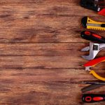 construction-tools-with-copy-space-on-a-wood-background_222342-84
